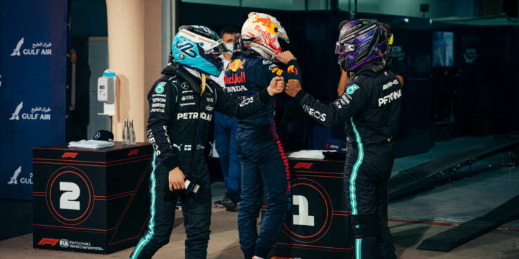 Bottas and Hamilton fist-bump behind Verstappen after Bahrain qualifying