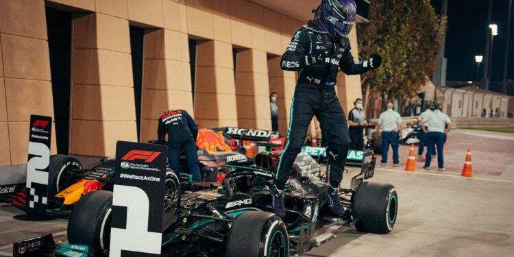 Lewis Hamilton jumps out of his car after winning the Bahrain Grand Prix